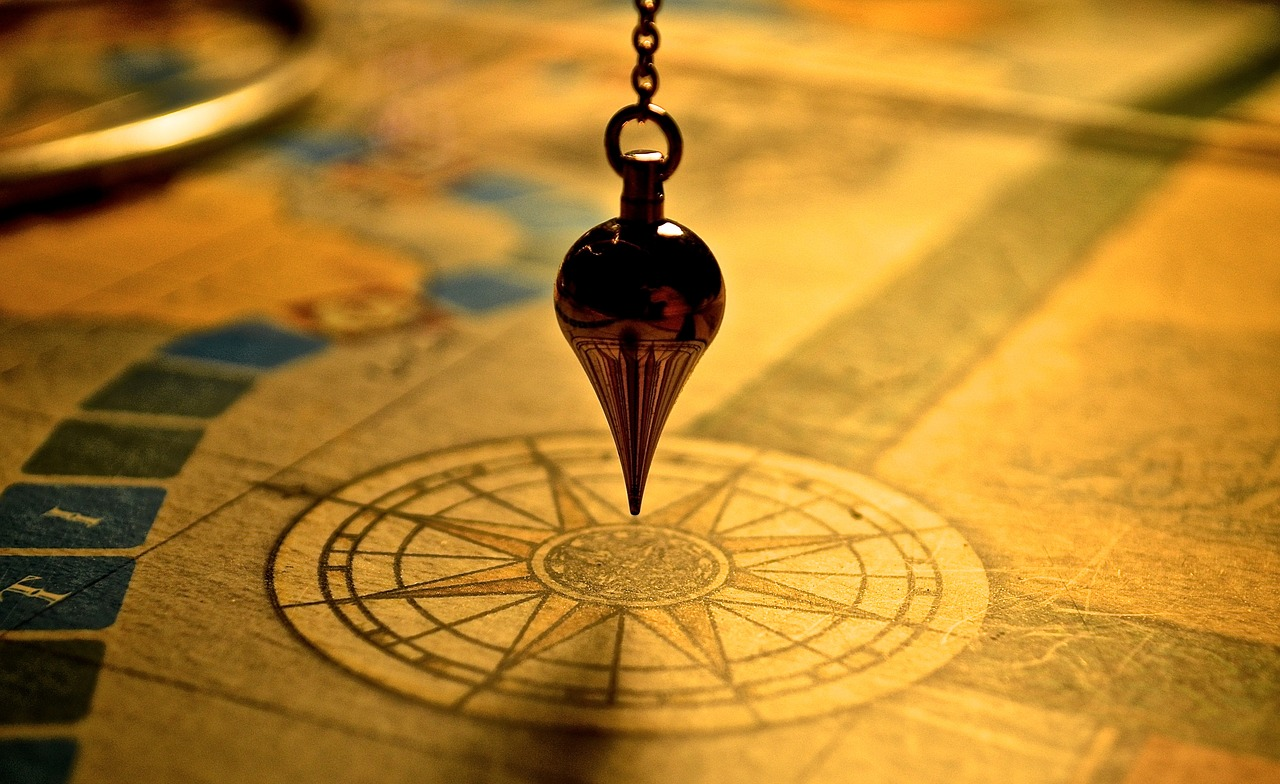 A pendulum over a map