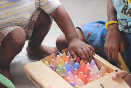Children playing with chalks