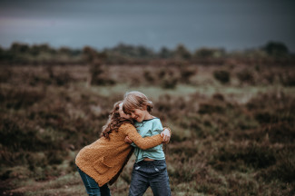 Girl and boy hugging on the countryside